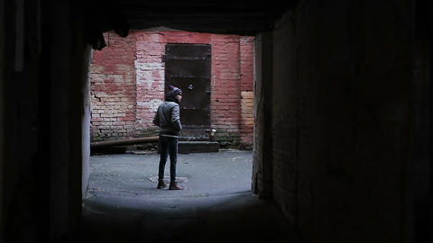 Young person facing dead end, choosing which way to go, right or wrong choice Footage