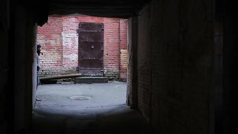 Dangerous deserted place, homeless teenager wandering in abandoned backstreet Footage