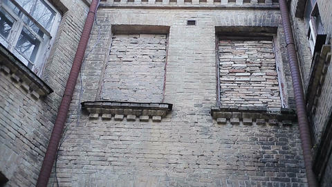Scary brick wall with immured windows, complete isolation, mental health clinic Footage