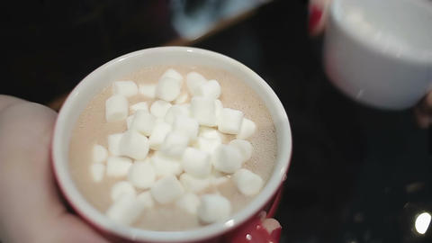 Close up shot, lady's hands with cup of warm drink adding sweets, romantic date Footage