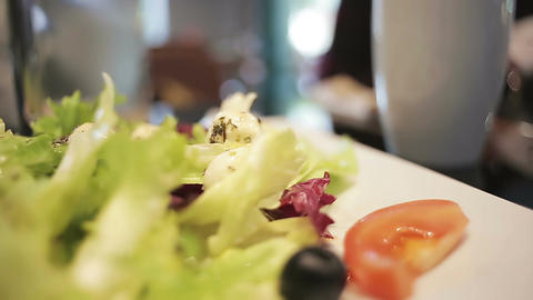 Extreme closeup of vegetable salad, woman serving healthy breakfast for family Footage