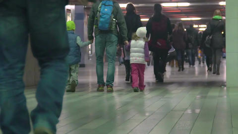 Many people walking through underground passage at airport or railway station Footage