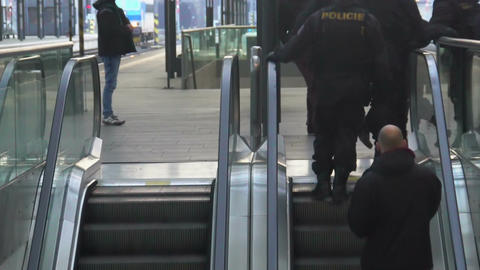 Railway station secured by many policemen, police squad patrolling city Footage