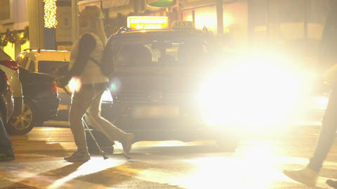 People crossing the road at crosswalk, evening time, relaxation. Slowmotion Footage