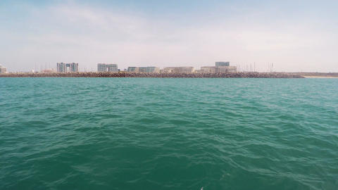 Boat tracking shot from the mediterranean sea of herzliya marina in israel Footage