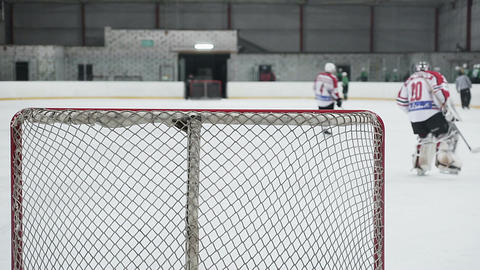 Hockey teams end practice match, defocused players and referee leaving ice rink Footage