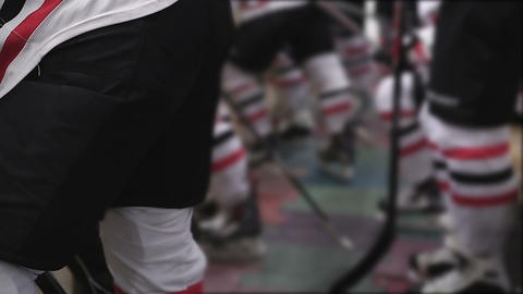 Feet of hockey players wearing team uniform and blades, preparing for match Footage
