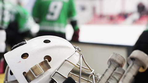 Ice hockey helmet and stick closeup, team players preparing for practice match Footage