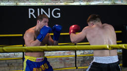Two boxers start fight training in boxing ring HD slow motion video. Sparring Footage