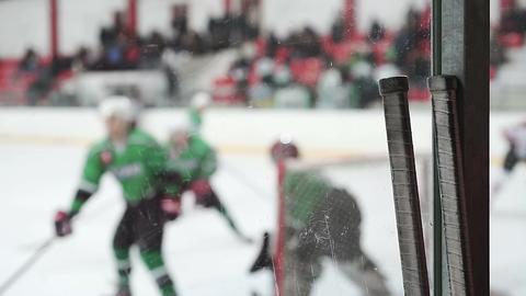 Intensive attack in ice hockey match, goaltender and defencemen saving goals Footage
