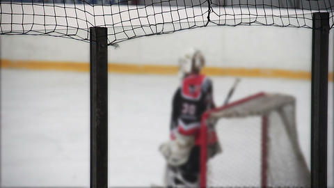 Professional goaltender taking up team's net, ready to return penalty shots Footage