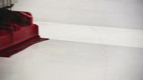 Resurfacer machine cleaning and polishing smooth ice rink before competition Footage
