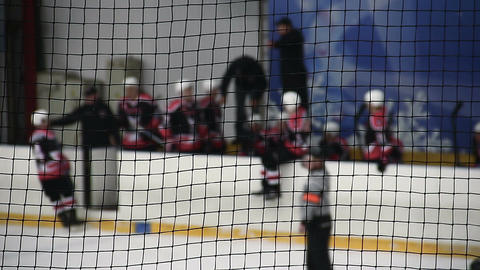 Team coach giving instructions to hockey players before they enter ice rink Footage