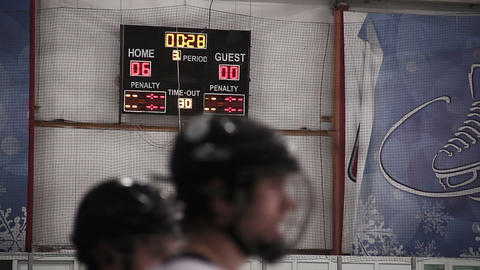 Final countdown in last period of hockey match on scoreboard, home team wins Footage
