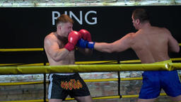 Two boxers fight in boxing ring HD slow motion video. Fighter being punched head Footage