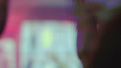 Pleased people applauding DJ in the night club, party atmosphere, nightlife Footage