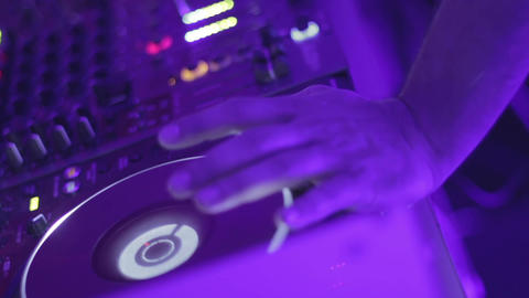 Male hand on dj turntable, disk jockey mixing music records, nightclub party Footage