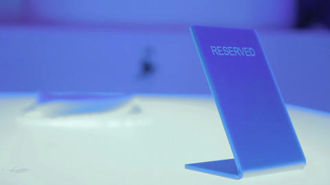 Reserved card standing on table at restaurant, service for clients' comfort Footage
