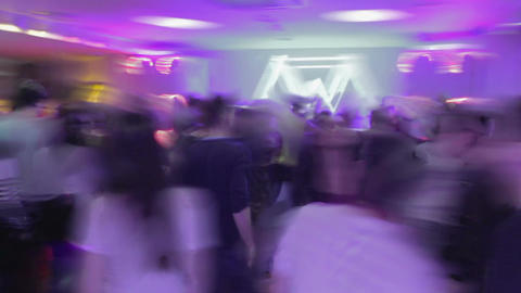 Timelapse shot of nightclub party atmosphere, people having fun on dance floor Footage