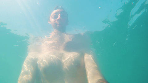 Underwater shot of a man swimming in the sea Footage