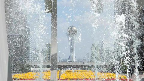 A view of the Baiterek through fountain spray. Astana, Kazakhstan Footage