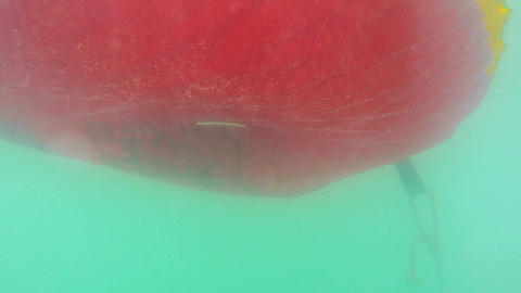 Underwater view of a moving inflatable ring that floating in the water Footage