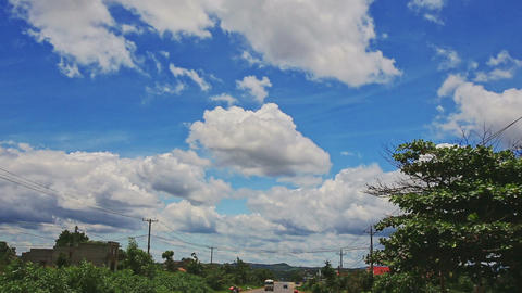 Blue Cloudy Sky over Traffic Road among Country Houses Footage