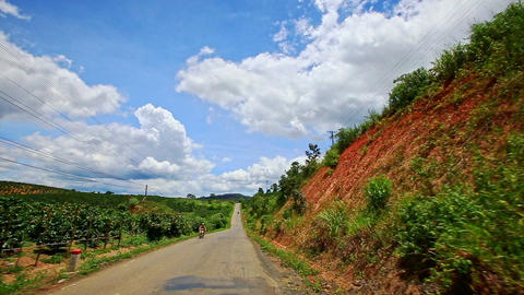 Motion along Country Road to Skyline past Forestry Hilly Slopes Footage