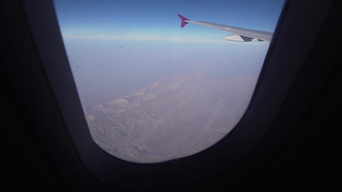 View from an airplane window on mountains Live Action