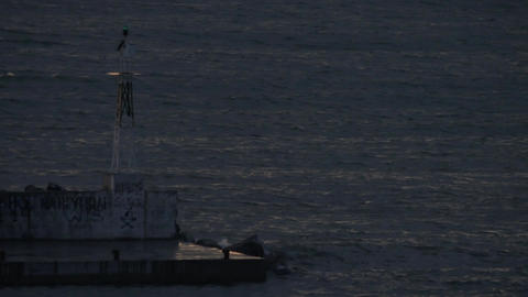 In Nea Kallikratia, Greece in night sea is lighthouse and burns the bulb Footage