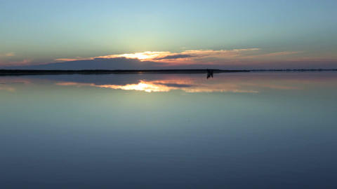 Sunset on the lake, mirror, Romania Footage