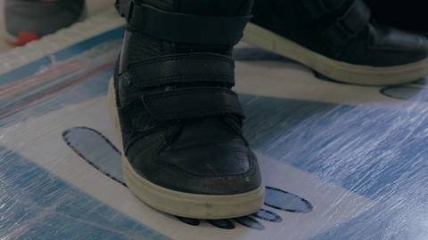 Close up view of boy's feet in black sneakers Footage
