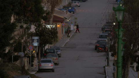 In Nea Kallikratia, Greece seen quiet street with parked cars and trees Footage