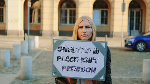 Woman protesting that shelter in place does not mean freedom Live Action