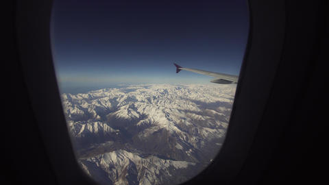 View from airplane window on mountains Live Action