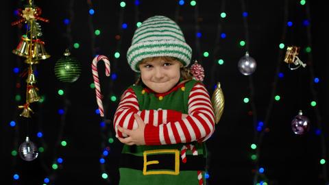 Displesed kid teenager girl in elf Santa helper costume negative emotions, upset Live Action