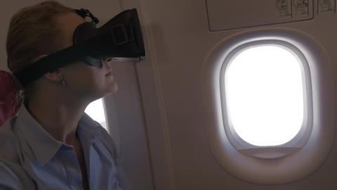 Woman exploring virtual world during the flight Footage