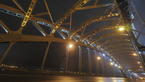 Timelapse of car traffic on the bridge at night Footage