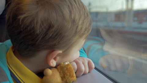 In Saint-Petersburg, Russia in train rides a little boy who looks out the window Footage