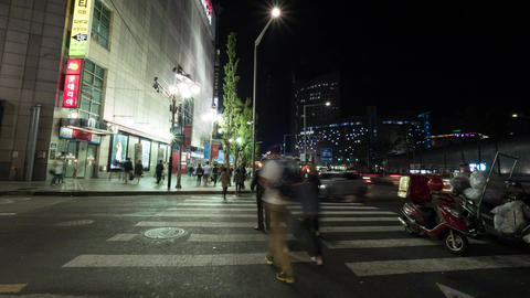Timelapse of people on zebra crossing at night. Seoul, South Korea Footage