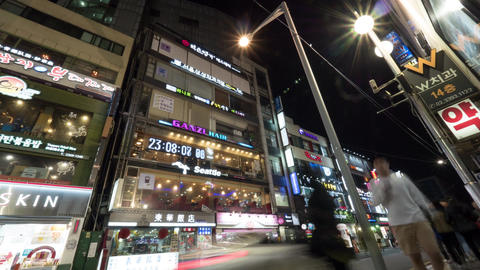 Timelapse of night street with illuminated banners on the buildings. Seoul, Sout Footage