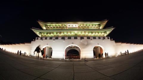 Timelapse of people at Seoul landmark Gwanghwamun Gate at night Footage