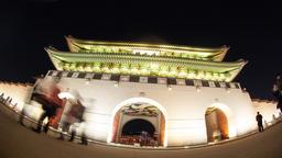 Timelapse of people visiting Gwanghwamun Gate in Seoul at night Footage