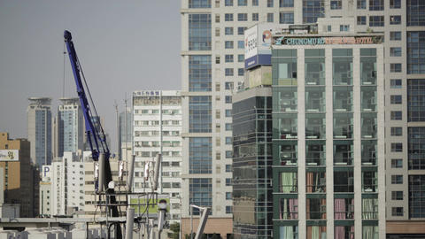 Timelapse of working crane and windows cleaners in Seoul, South Korea Footage