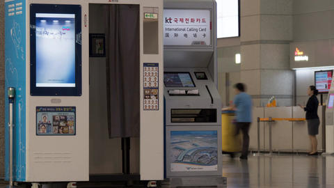 Timelapse of people walking by self-service machines at airport Footage