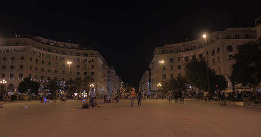 People are walking along the pedestrian street in the evening Footage