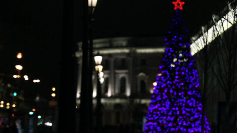 Christmas tree sparkles in the night city Footage