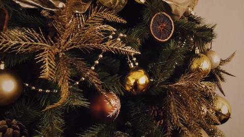 Golden Christmas tree look, decor in country style as holiday home decoration Live Action