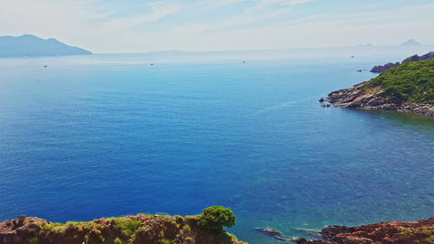 Hilly Coastline and Boundless Azure Ocean against Blue Sky Footage
