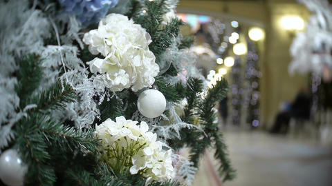 White balls and flowers. New Year's and abstract blurred shopping mall backgroun Footage